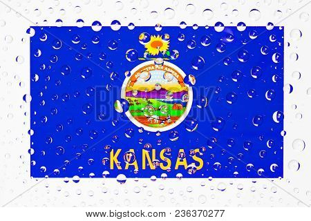 Flag Of American State Kansas Behind A Glass Covered With Raindrops. Patriots Day, Memorial Weekend,