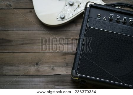 Guitar Amplifier And A Electric Guitar On Wood Table
