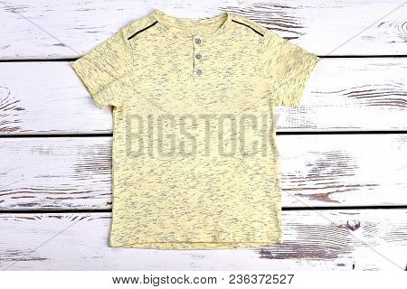 Boys Yellow Cotton T-shirt. High Quality Natural T-shirt For Boys On Old Wooden Background. Summer C