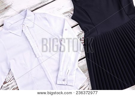 Set Of Traditional School Clothes For Girls. Girls White Blouse And Black Pleated Dress For School W