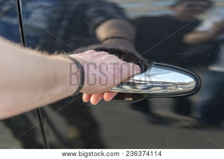 The Man's Hand Opening The Door In The Car