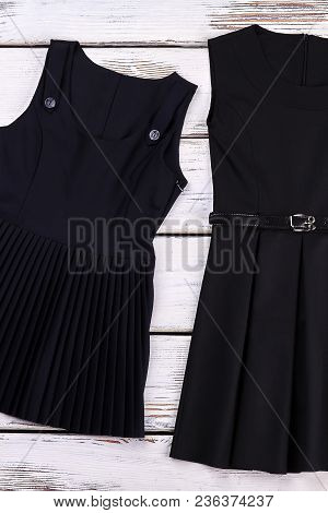 School Girls Classic Black Dresses. New Cotton Black Shool Dresses For Girls On Sale. Belted And Ple