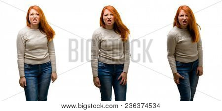 Young Beautiful redhead woman angry and stressful frowns face in dissatisfaction, irritated and annoyed, expressing anger