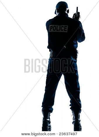 Rear view of an afro American police officer holding handgun on white isolated background