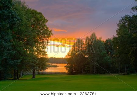 Sunset Over A Lakeside Golf Course