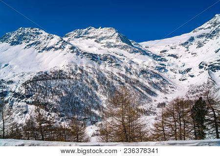 View Of Alps Covered With Snow From The Bernina Express Rail Journey Between St Moritz In Switzerlan