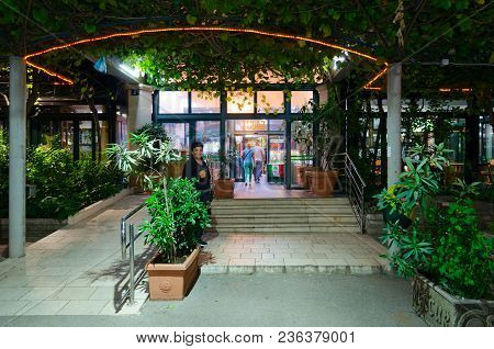 Budva, Montenegro - September 13, 2017: Unknown People Enter Bus Station Building In Evening In Popu