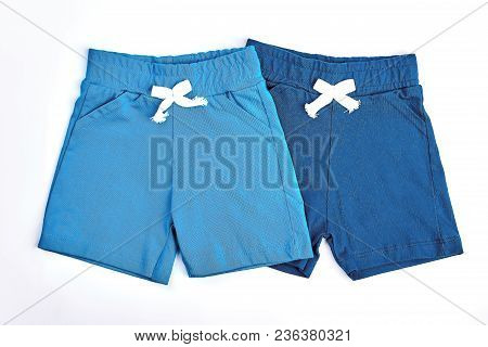 Set Of Colored Cotton Shorts For Kids. Collection Of New Childrens Cotton Shorts, White Background.
