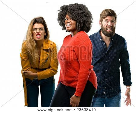 Group of three young men and women angry and stressful frowns face in dissatisfaction, irritated and annoyed, expressing anger