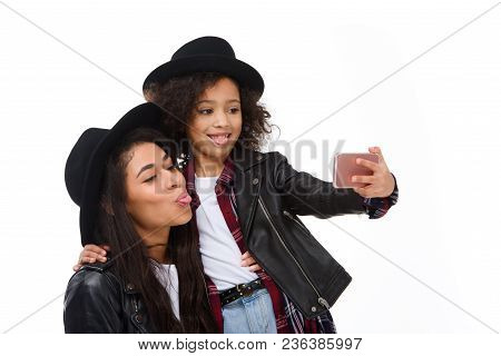 Stylish Mother And Daughter Taking Selfie With Smartphone And Grimacing Isolated On White