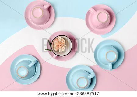 Overturned Coffee Or Tea Set. Plenty Of Elegant Porcelain Light Blue And Pastel Pink Cups Bottoms An