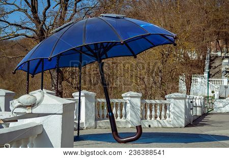 Umbrella With Solar Panels For Charging Gadgets. Kamianets Podilskyi. Ukraine.