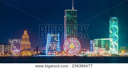 Batumi, Adjara, Georgia. Panorama Of Modern Architecture In Seafront. Miracle Park In Night Or Eveni