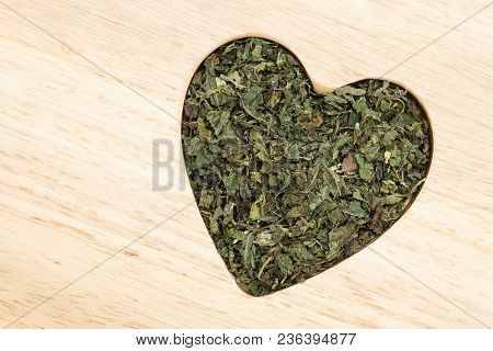 Healthy Food, Healing Herbs, Alternative Herbal Medicine Concept. Dried Herb Nettle Leaves In Form O