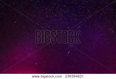 Night Starry Sky Background In Purple Magenta Colours. Night View Of Natural Glowing Stars.