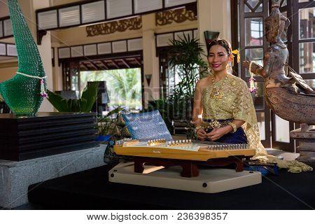 Bangkok, Thailand - April 15, 2018: Beautiful Thai Woman In Traditional Dress Costume Playing At Xyl