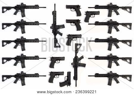 Collection Of Assault Rifles And Pistols Isolated On White Background