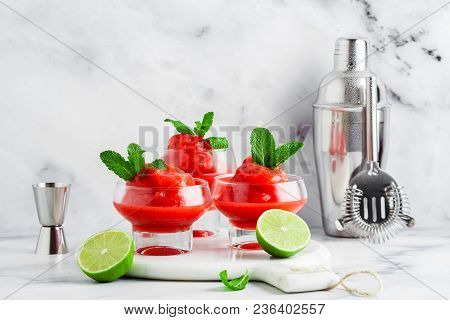 Berry Slushie With Lime, Summer Refreshing Drink In Serving Glasses. Bartender Tools In The Backgrou
