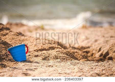 A Plastic Pail In The Sand.