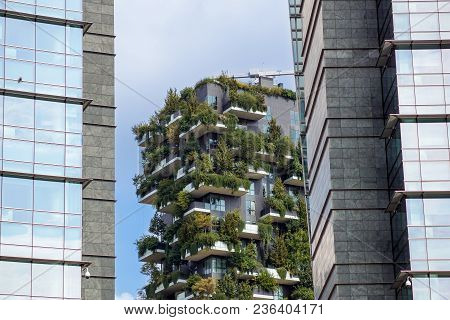 Milan, Italy - March, 2018: Skyscraper Vertical Forest With Trees Growing On Balconies, Built For Ex