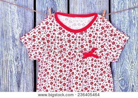 Toddler Girl Top Hanging On Rope. Little Girl Patterned Casual Dress Hanging On A Clothesline On Old