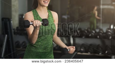 Fitness Woman With Dumbbells Standing At Gym. Unrecognizable Girl Have Intensive Training, Holding S