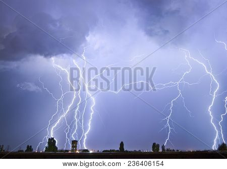 Lightning Flash Over A City, Thunderstorm , Electricity Blast Storm, Thunderbolt In Sky
