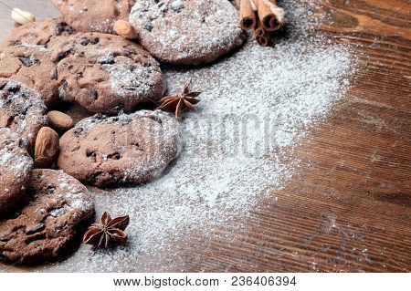 Chocolate Chips Cookies On Dark Rustic Texture With Copy Space For Your Text. Close-up View.