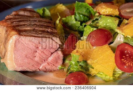 Thick New York Strip Beef Steak Cooked In Sous Vide And Grilled On Plate With Lettuce Salad