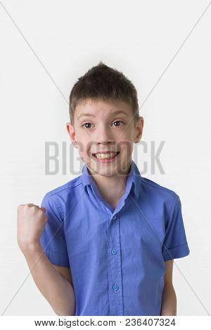 The Studio Shot Of A Happy Teen Boy Winning Over White Studio Background. Win, Winner Concept