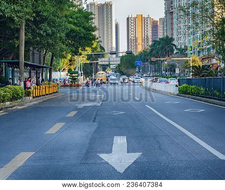 China, Shenzhen, 2018-03-09:  Close Up Empty Asphalt Road On City Street With Road Markings In The F
