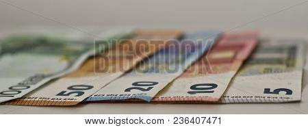 bank notes are on a table - euros