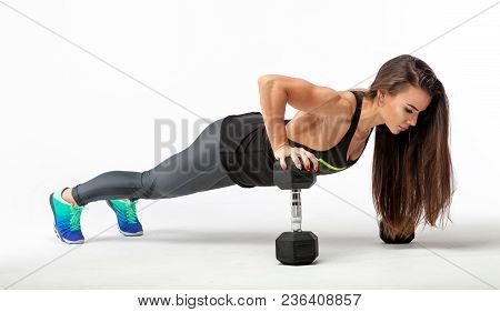Fitness Woman Warming Up And Doing Some Push Ups On A White Background. Gorgeous Brunette Woman Doin