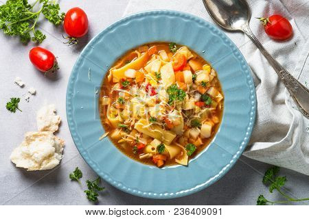 Minestrone Traditional Italian Soup From Vegetables, Tomato And Pasta. Meatless Dish. Top View.