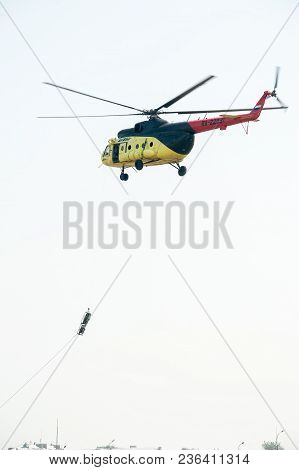 Tyumen, Russia - August 11, 2012: On A Visit At Utair Airshow In Plehanovo Heliport. Rescuers Lower