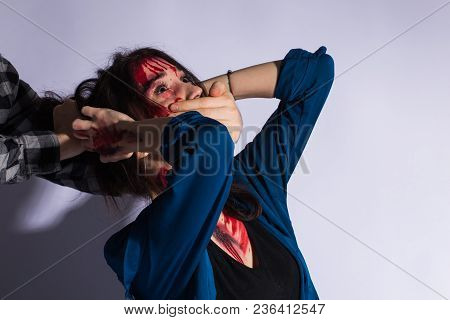 Sexual Abuse With A Man Attacking To A Scared Woman In A Dark Place