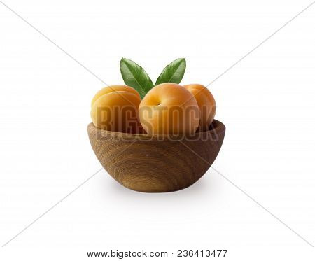 Ripe Apricots Isolate On A White. Bowl With Apricots With Leaves Isolated On White Background. Ripe
