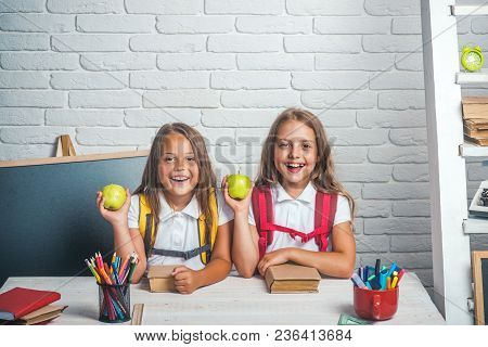 Back To School And Home Schooling. Friendship Of Small Sisters In Classroom At Knowledge Day. Little