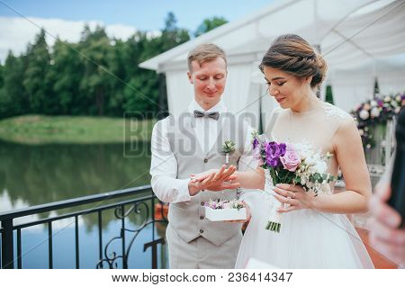 Bride And Groom At The Wedding Ceremony On The Lake
