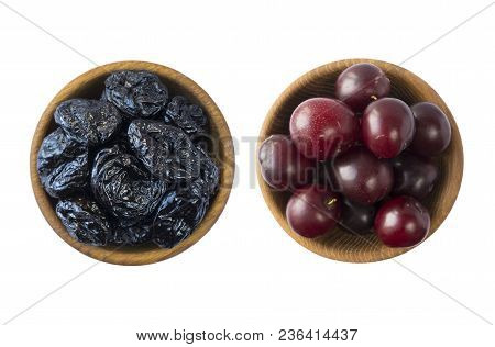 Fresh Plums And Dried Prunes Isolated On A White Background. Dried Prunes And Fresh Plums In A Bowl