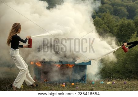 Firefighting Of Girl With Extinguisher. Sexy Woman With Long Hair At Piano On Fire, Halloween. Music