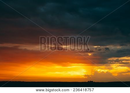 Sunrise Sky Landscape. Natural Bright Dramatic Sky In Sunset Dawn. Yellow And Orange Colors Above Da