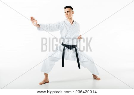 Male Karate Fighter Standing In Pose Isolated On White
