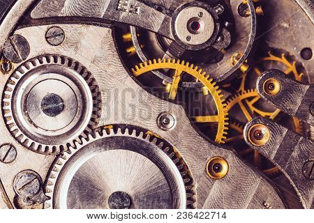 Clockwork Background. Close-up Of Old Clock Watch Mechanism. Retro Clockwork Watch Mechanism With Gr