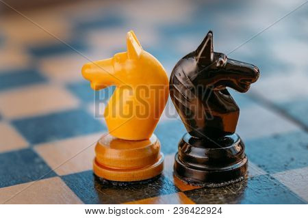 Chess Pawns Standing On Old Vintage Chessboard