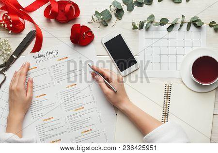 Wedding Arrangement Background. Female Hands Preparing For Marriage, Smartphone, Paper Calendars And