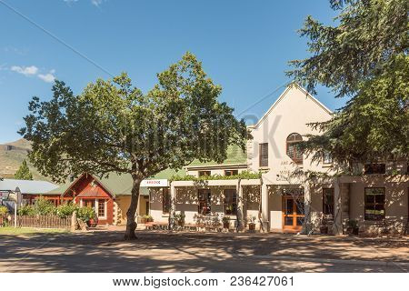 Clarens, South Africa - March 12, 2018: A Street Scene With An Art And Wine Gallery In Clarens In Th