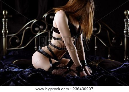 Beautiful Sexy Lady In Bdsm Outfit. Close Up Fashion Portrait Of Model In Black Panties Indoors. Bea