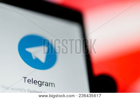 Moscow, Russia - April 16, 2018: A Mobile Phone With The Telegram App In Hand Against A Prohibiting