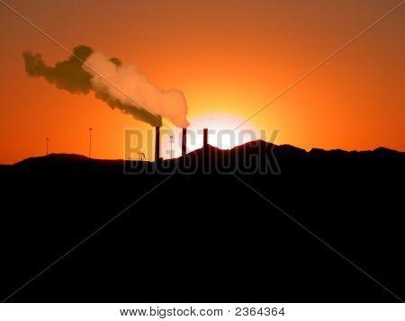 Smoke Stack At Sunset
